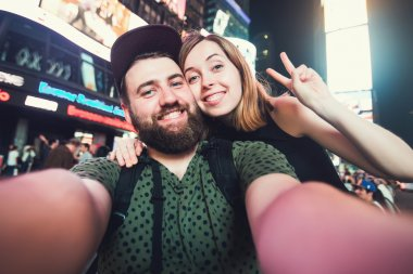 Happy couple in love taking selfie