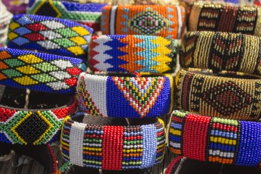 Local craft market in South Africa. Unique handmade colorful beads  bracelets, bangles. Craftsmanship. African fashion. Traditional ornament, accessories.