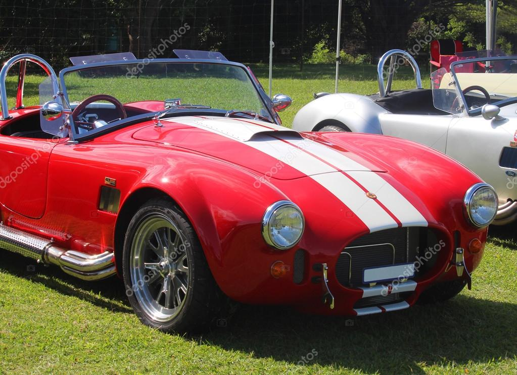 Red old model sport car AC Cobra at the festival Highland Gathering ...