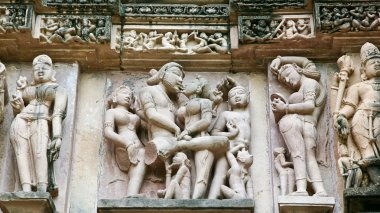 Bas love. The frescoes of the temple Lakshmana displayed scenes of erotic relations. Some scenes included in the collection of the Kama Sutra. The bas-reliefs and murals in the Temple of Love in India, 02 September 2006: The temples at Khajuraho