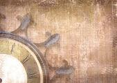 Fotografie Fragment der alten Mauer-Uhr mit römischen Zahlen auf Grunge hintergrund. Abstrakte Komposition für Ihr Design. Braun Illustration des Teil-Zifferblatt ohne Pfeile in Form von Rad Schiff