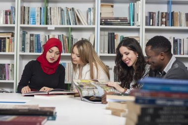 Group of students studying at university library