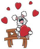 zajíček sedí na lavičce a drží srdce
