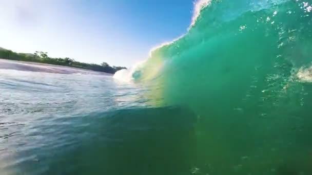 Blue Ocean Wave Crashing in Slow Motion. Shore Break in HD.