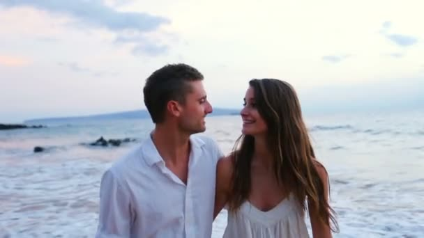 Young Couple Laughing on Beach