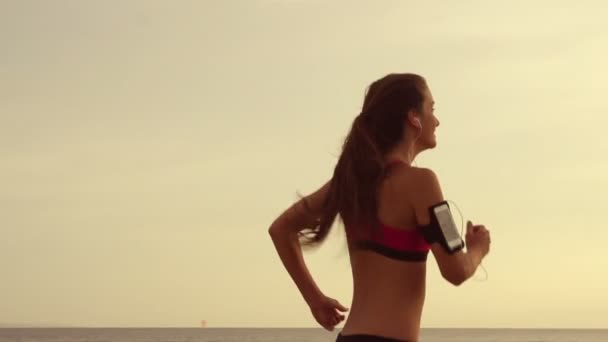 Woman Running in Slow Motion Listening to Music