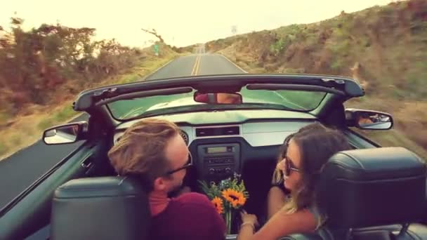 Attractive Young Couple Driving Convertible Car