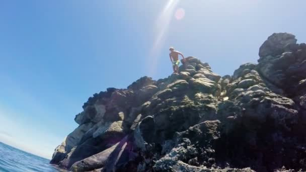 Tropical Cliff Jumping into Blue Ocean.