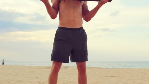 Fit Young Man Exercising on Beach. Crossfit Work Out. Healthy Active Lifestyle.