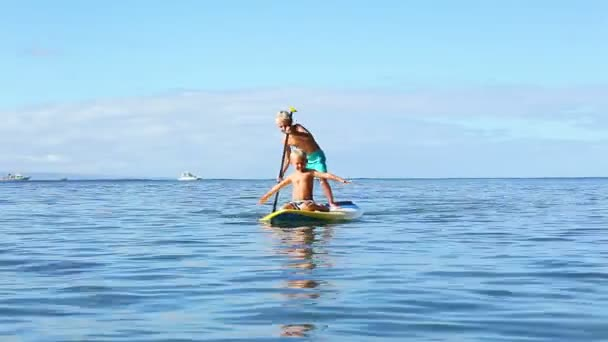 Happy Young Boys Stand Up Paddling in Hawaii.