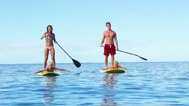 Happy Family Stand Up Paddling in Hawaii.