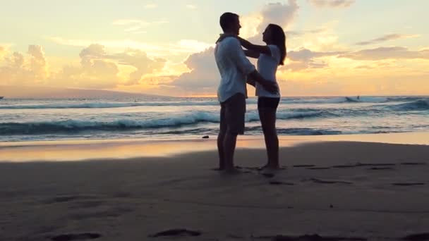 Passionate Couple in Love at Beach Sunset. Woman Jumping into Mans Arms