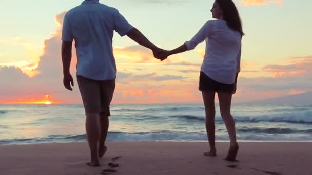 Passionate Couple in Love Walking into Amazing Sunset