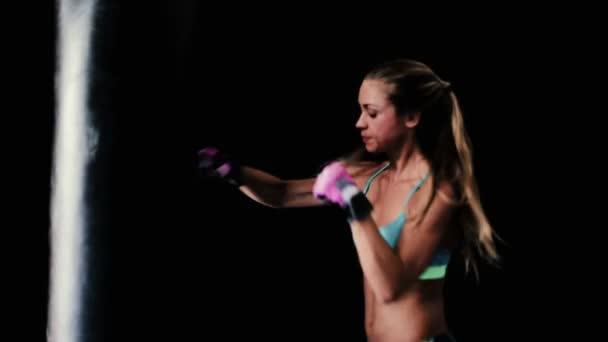 Beautiful Young Female Athlete Punching Body Bag. Self Defense Training.