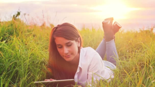 Young Woman Using Tablet Computer Touchscreen Outdoors In Nature. Beautiful Vintage Sun Flare