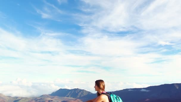 Young Woman Sitting on top of Mountain with Backpack. Helthy Nature Adventure Lifestyle