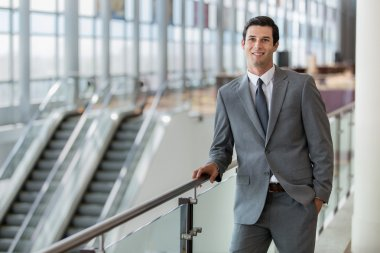 Business man professional portrait pose traveling for work at the airport station confident and successful expression
