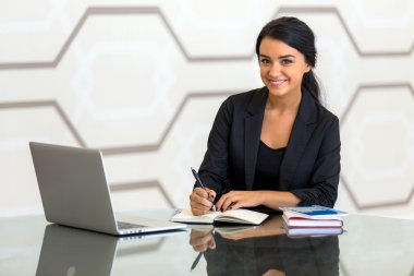 Office consultant executive woman business finance in suit smiling while working
