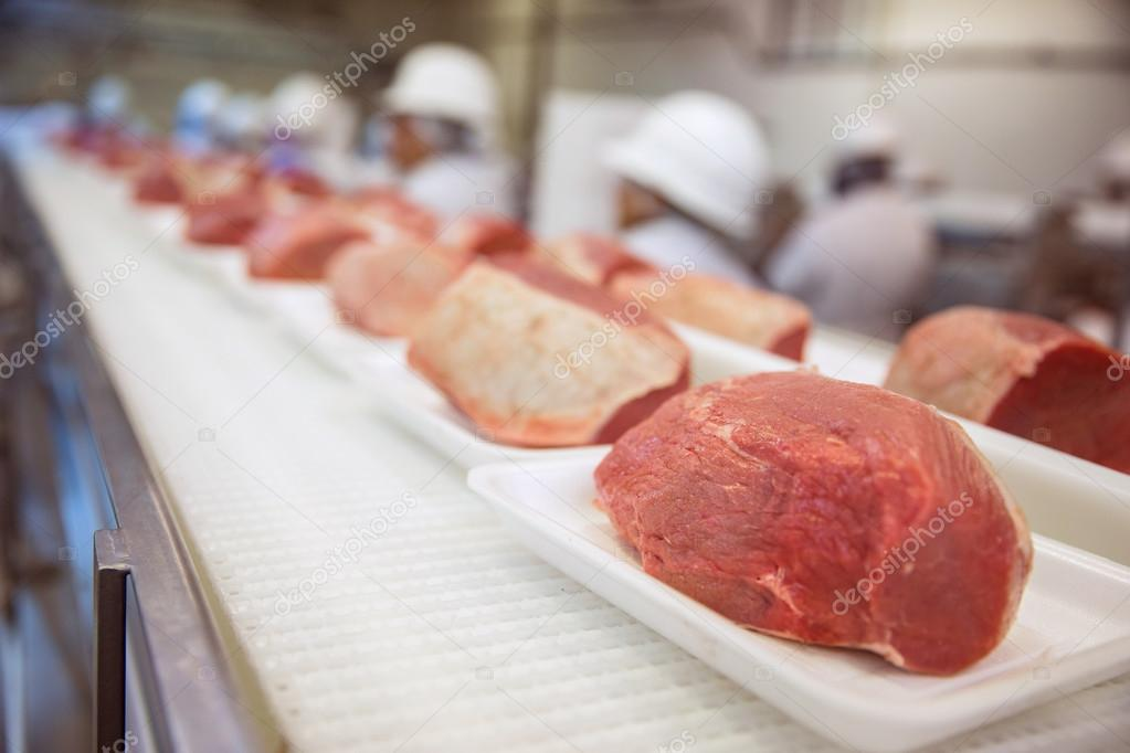 Rows of grouped meats before it is delivered to the grocery store