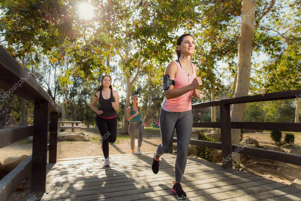 Jogging group of people in park outdoors healthy and active females vibrant young energetic positive