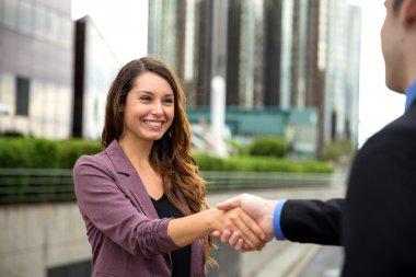 Pretty female businesswoman new career interview client handshake employment