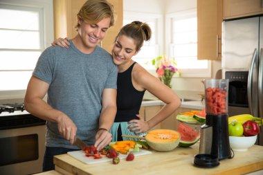 Healthy nutrition minded nutritionist prepares low calorie smoothie juicer vegan vegetarian