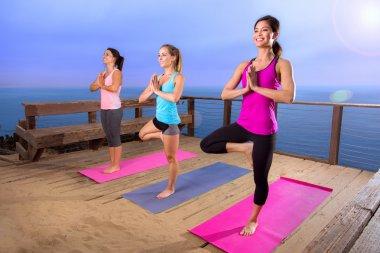 Yoga retreat nature outdoors women at beautiful location hill landscape ocean travel