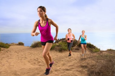 Runners jogging on hike on mountain trail path outdoors in sportswear cross country endurance training