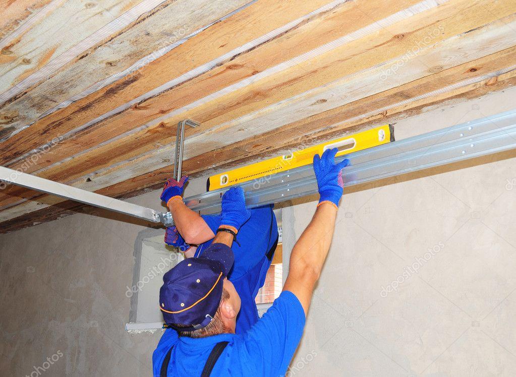 Contractors Installing Garage Door Metal Profil Post Rail