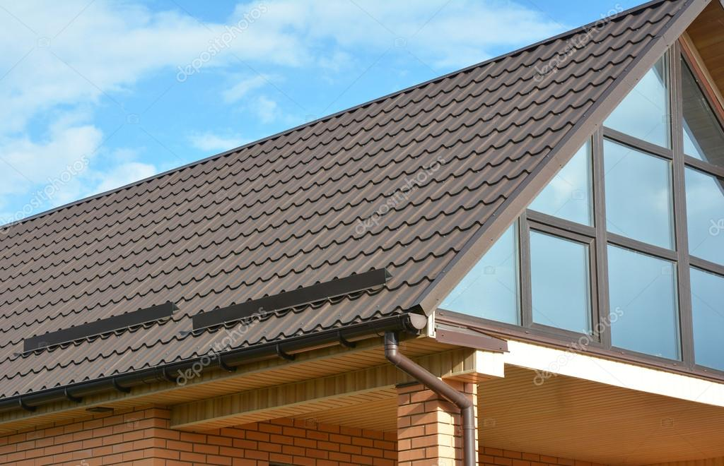 Building modern house construction with metal roof rain for Contemporary roofing materials