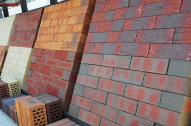 Stacks of various colored concrete pavers (paving stone) or pati