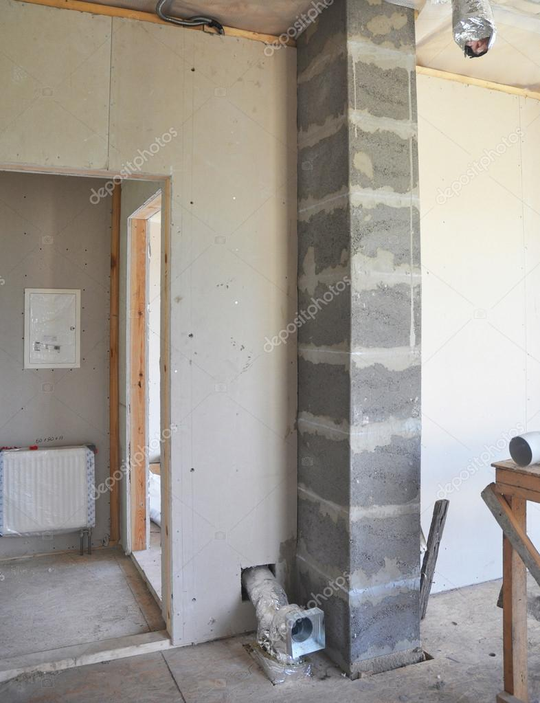 Building new modular chimney from pumice stone blocks.