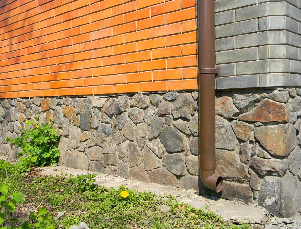Rain Gutter Without Any Drainage Systems Near House Foundation