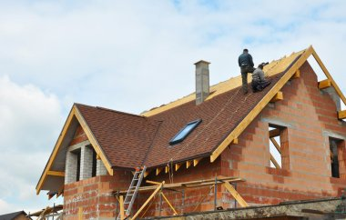 Roofers and Roofing Construction and Building New Brick House with Modular Chimney, Skylights, Attic, Dormers and Eaves.
