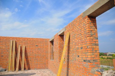 Interior of a Unfinished Red Brick House Walls under Constructio