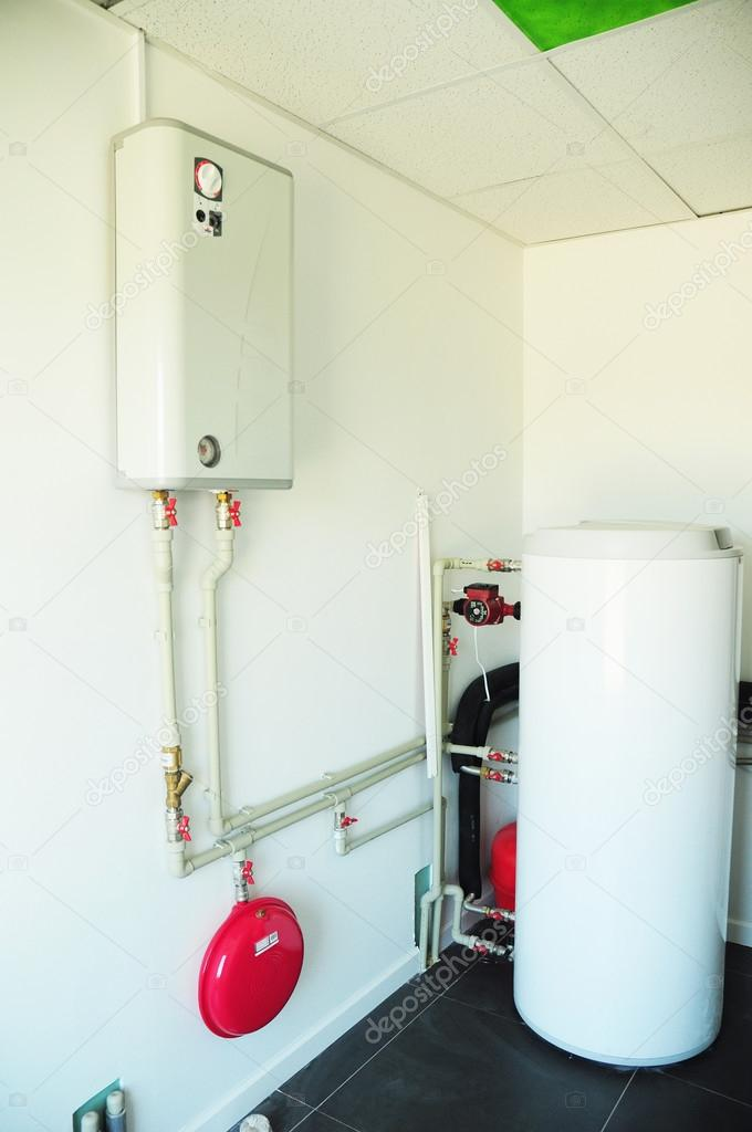 A domestic household boiler room with a new modern gas boiler ...