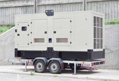 Mobile Diesel Generator near Office Building Wall