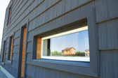 Close up on Window in New Modern Passive House Facade Wall