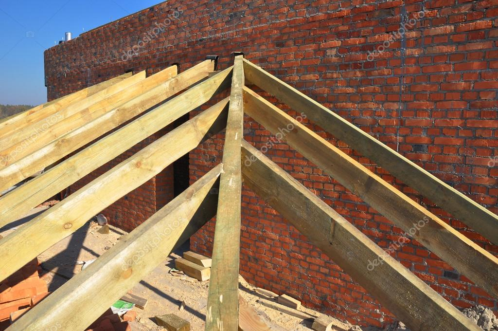 Roofing Construction. Close Up On Wooden Rafters, Eaves, Wooden Beams  Installed On Brick
