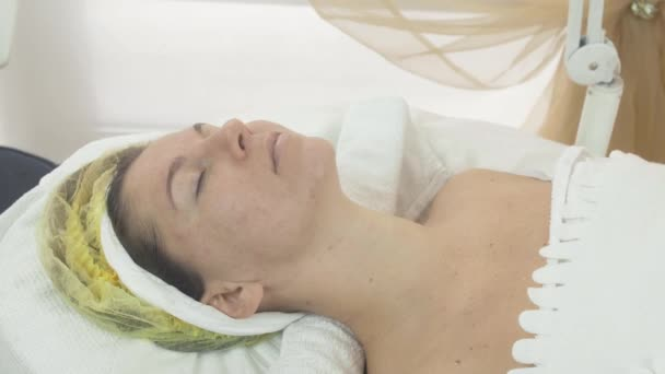 Woman face with closed eyes in beauty saloon on cosmetic procedure. Problem skin