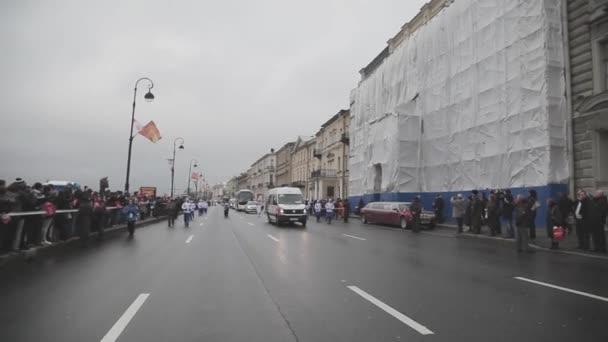 SAINT PETERSBURG, RUSSIA - OCTOBER 27, 2013: Relay race Sochi Olympic flame in Saint Petersburg in October. Olympic cortege. Torchbearer. People
