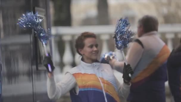 SAINT PETERSBURG, RUSSIA - OCTOBER 27, 2013: Relay race of Olympic flame in Saint Petersburg in October. Happy girls and boy in bus wave pom pom.