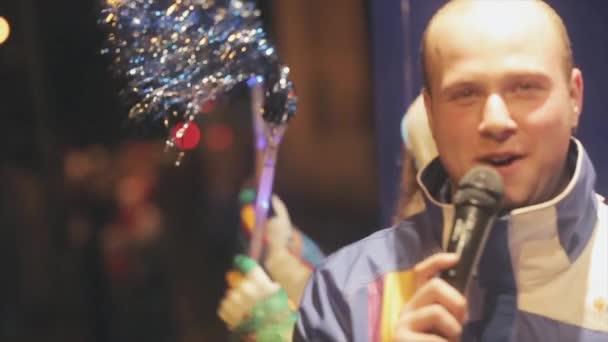 SAINT PETERSBURG, RUSSIA - OCTOBER 27, 2013: Relay race of Olympic flame in Saint Petersburg in October. Happy man in bus speak in microphone.