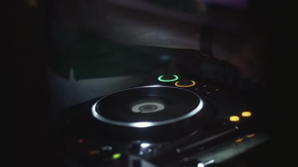 Dj spinning at turntable on party in nightclub. Holidays. Equipment. Mixing