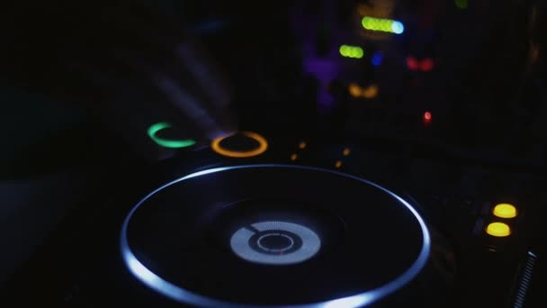 Dj in headphones spinning at turntable on party in nightclub. Disk. Rotating