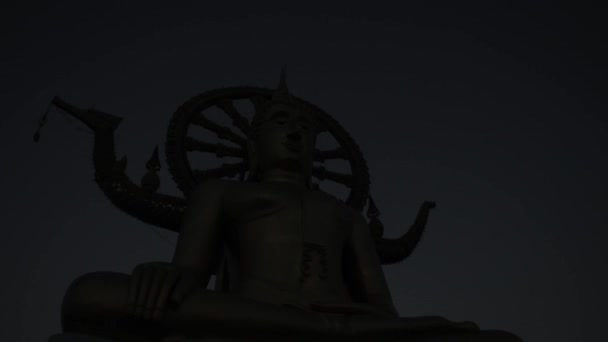 Big statue of Buddha on sunrise. Blue sky, Indian culture. Religion. Timelapse