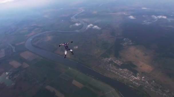 Skydiver free style in evening cloudy sky. Speed. Extreme sport. Falling. Land