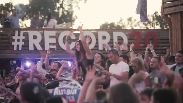 ST. PETERSBURG, RUSSIA - AUGUST 15, 2015: 20 years of Radio Record. Girl sits on the shoulders of a friend at a party.