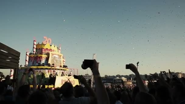 ST. PETERSBURG, RUSSIA - AUGUST 15, 2015: 20 years of Radio Record. Confetti sequins falling at stage. Slow motion