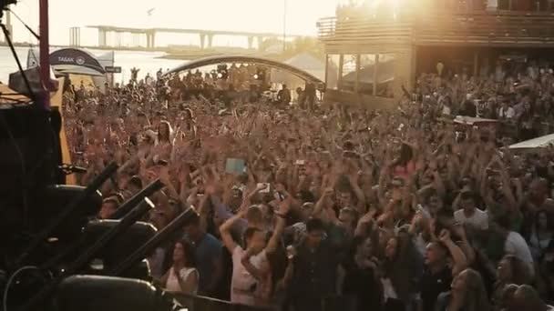 ST. PETERSBURG, RUSSIA - AUGUST 15, 2015: 20 years of Radio Record. People raise hands up, clap with dj. Slow motion